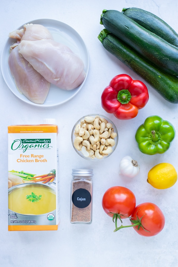 Bell peppers, blackened seasoning, and chicken breasts come together to make this low carb cajun chicken and zucchini recipe.