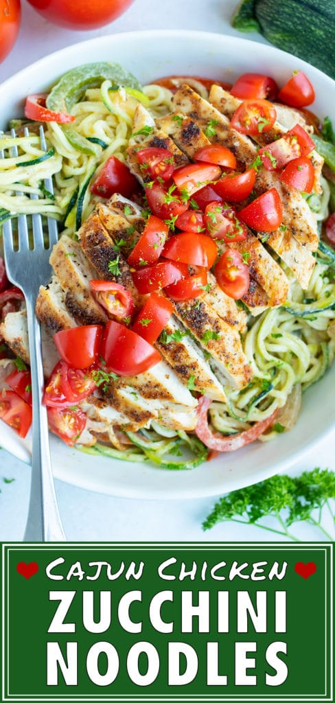 Seared cajun chicken is laid on a bed of vegetable pasta and topped with fresh tomatoes for an easy, low carb dinner.