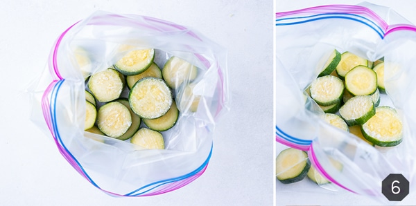 Sliced zucchini is placed into a freezer ziplock bag for keeping in the freezer for future recipes.