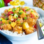 Instant Pot Hawaiian Chicken is loaded with bell peppers, sweet pineapple, and savory chicken and served with rice.