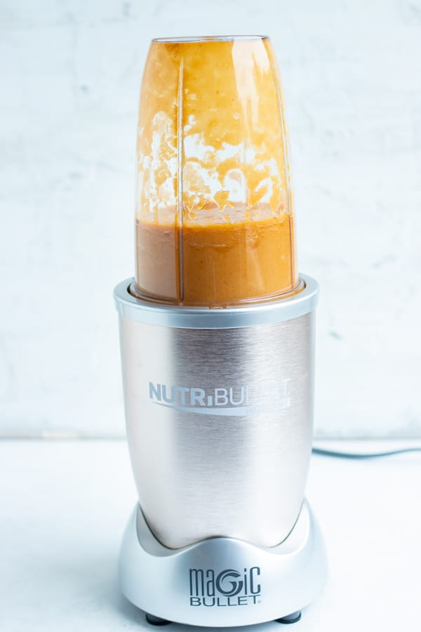 Pineapple sauce ingredients are combined and mixed into a blender until completely smooth.