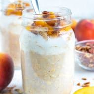 Oatmeal, yogurt, fresh peaches, and toasted pecans are combined in a mason jar for this easy overnight oats recipe.