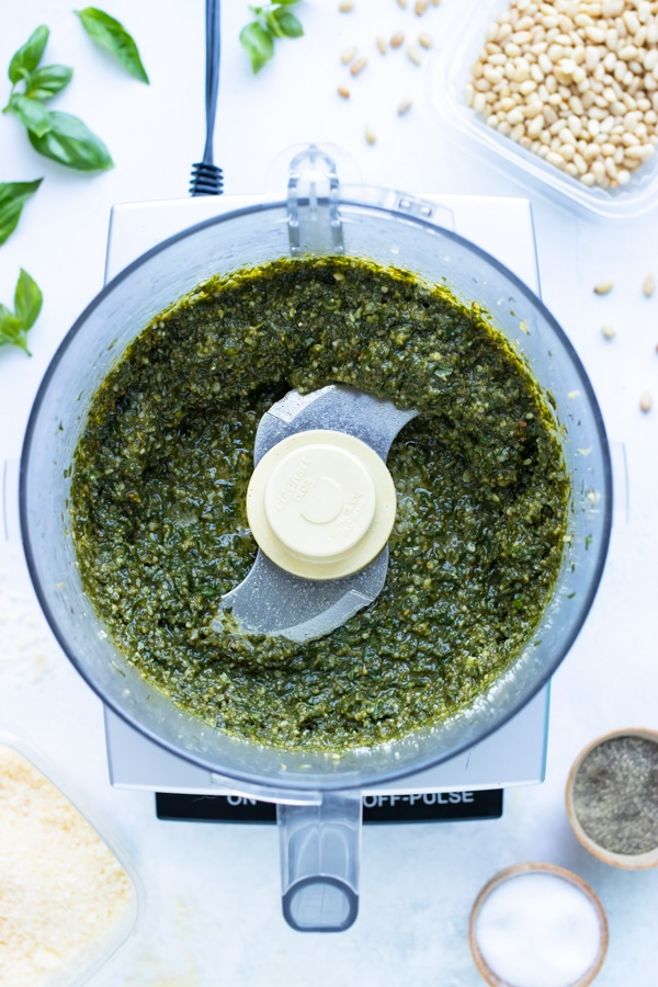 Using a food processor, blend the ingredients together to make this easy basil sauce.