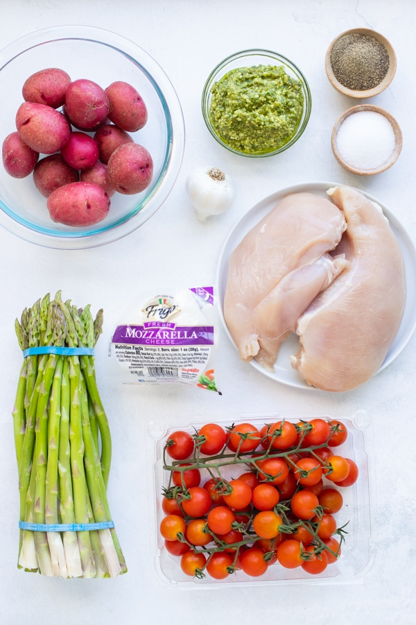 Chicken breast, potatoes, mozzarella cheese, pesto, tomatoes, and other ingredients come together in this Sheet Pan Caprese Chicken meal.