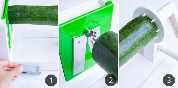 How to use a spiralizer to grate zucchini into zucchini noodles.