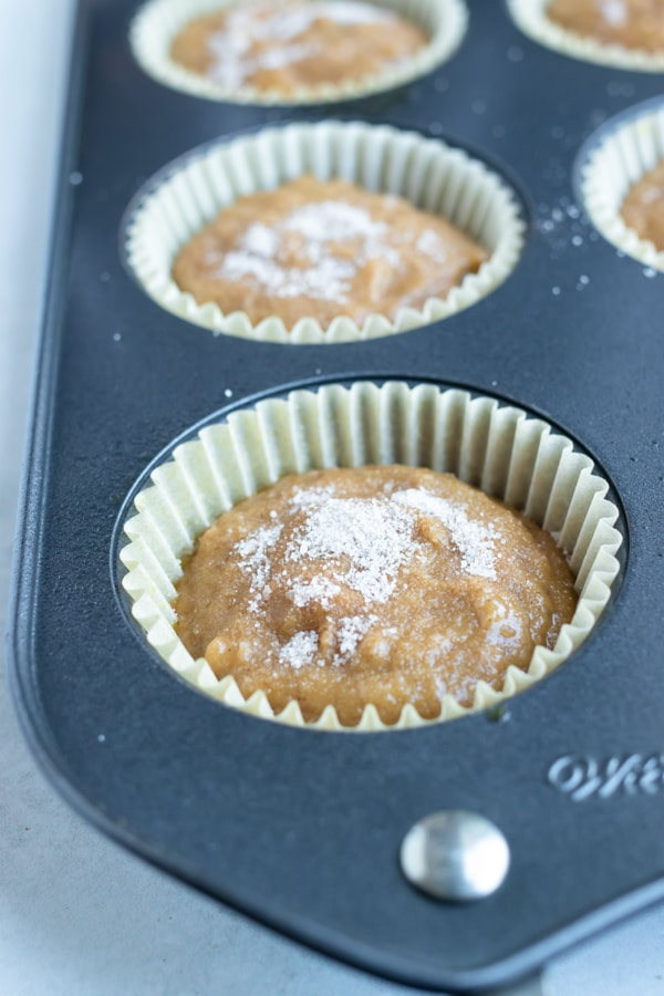 Fill muffin tins with applesauce muffin batter for a quick and easy breakfast.