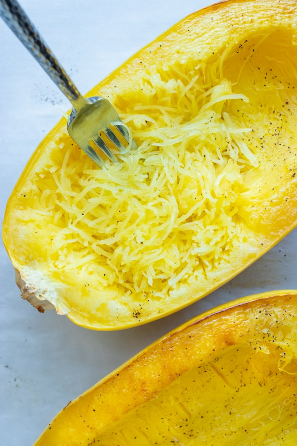 Use a fork to shred spaghetti squash after it is roasted in the oven.