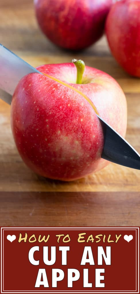 Lay the apple flat on the cutting board and then cut the apple into similar sized slices.