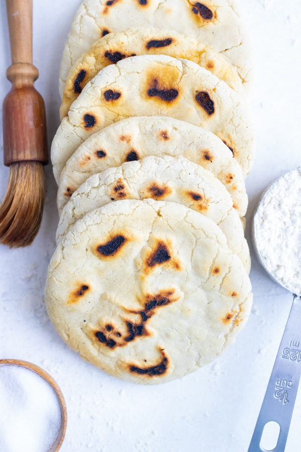 Homemade pita bread is placed on the counter before eating with Mediterranean recipes.