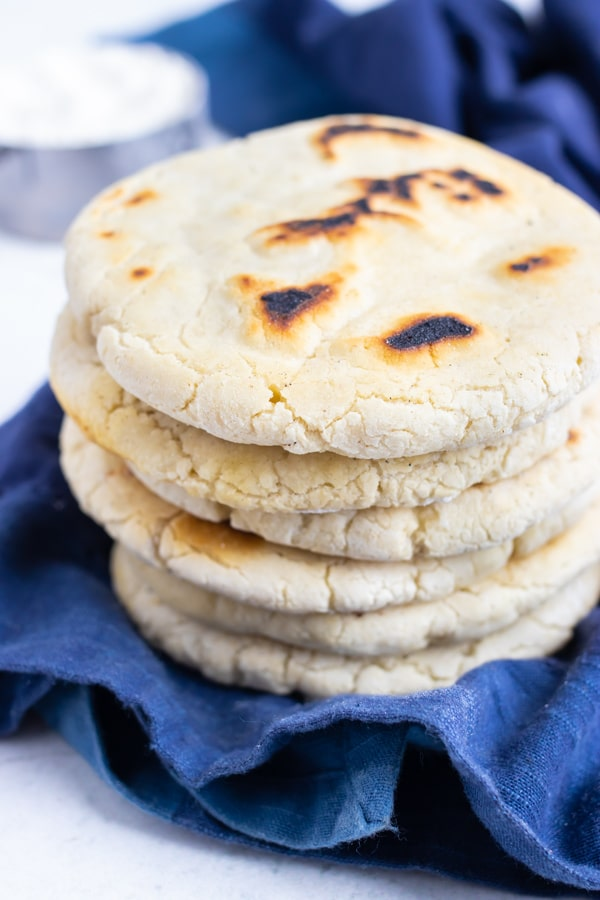 Gluten-Free pita bread made in under 30 minutes is stacked on the counter for an authentic side.