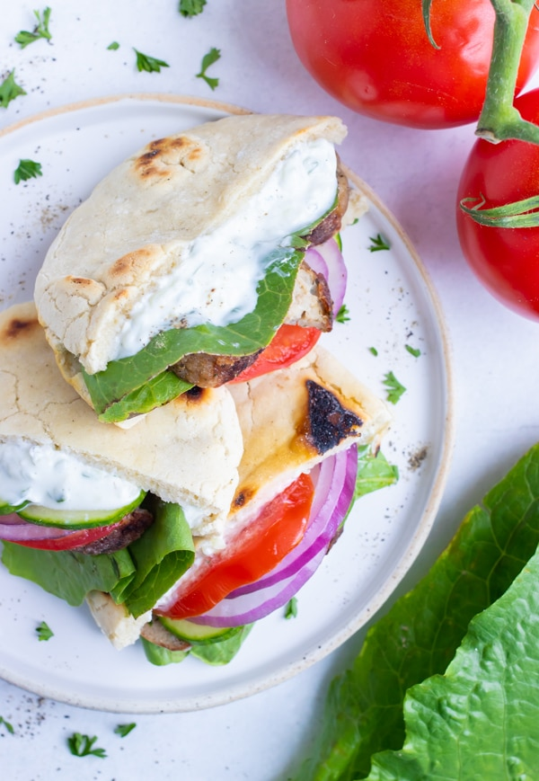 Gluten-free pita pockets that are filled with meat, vegetables, and tzatziki sauce.