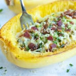 Shred roasted spaghetti squash and top with carbonara sauce and bacon.