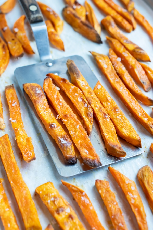 Learn how to make crispy sweet potato fries in the oven for an easy side.