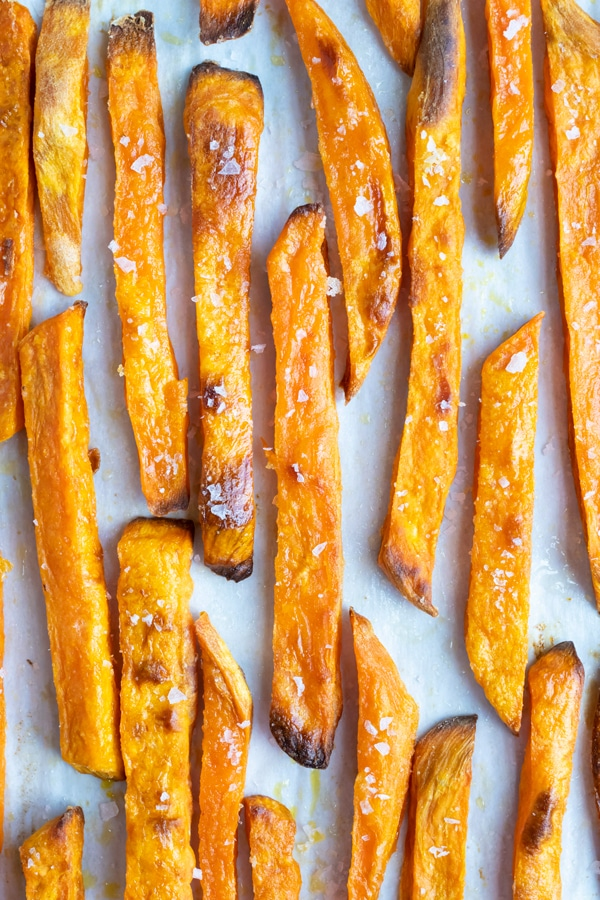 Sprinkled with salt and pepper or other seasonings, homemade sweet potato fries are baked in the oven.