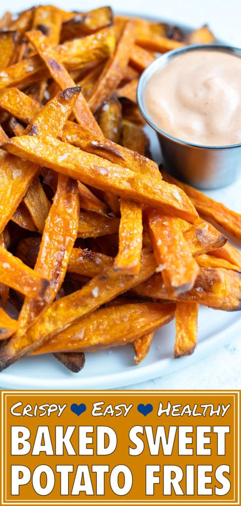 Oven baked sweet potato fries are cooked on a baking sheet for a crispy, gluten-free side dish.