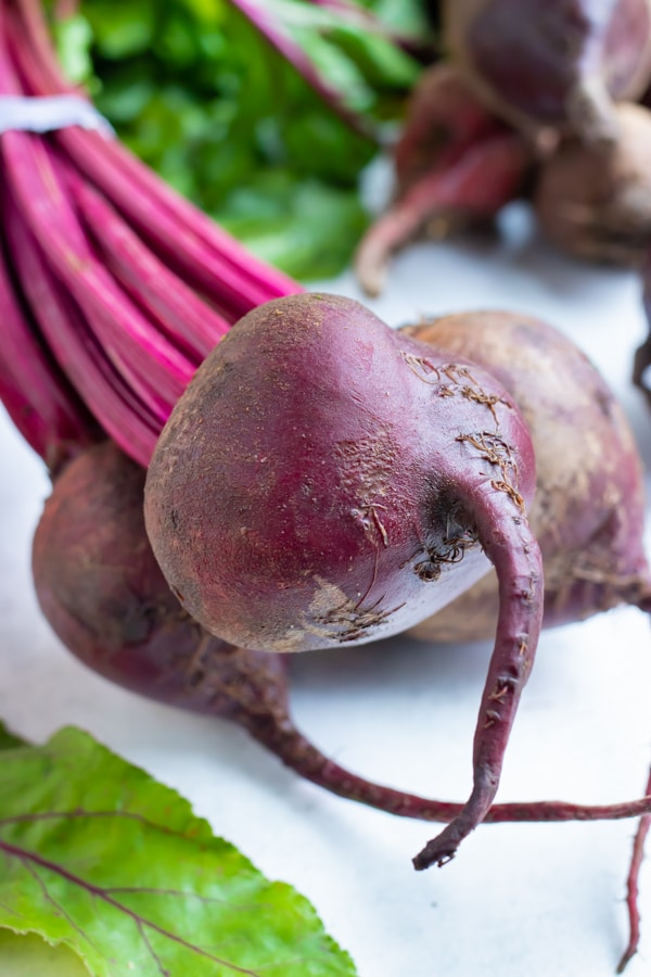 Learn how to boil whole beets for salad or soup recipes.