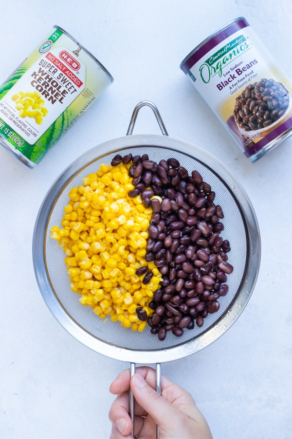 Canned corn and black beans are drained and rinsed before adding to this stew like chili.