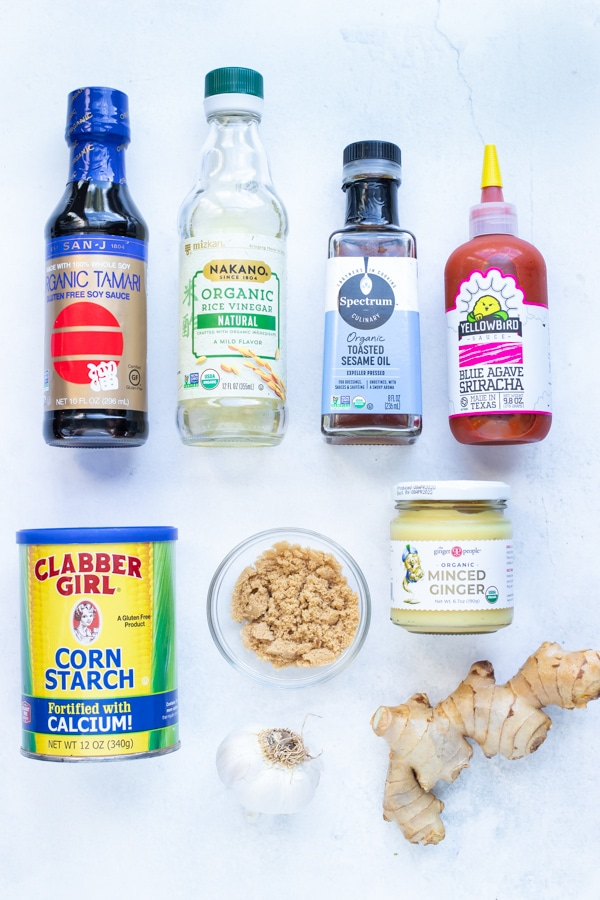 Soy sauce, ginger, sriracha, rice vinegar, honey, and garlic are ingredients used in this homemade teriyaki sauce.
