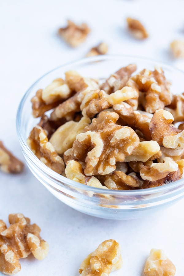 Toasted walnuts are placed in a bowl for a snack.