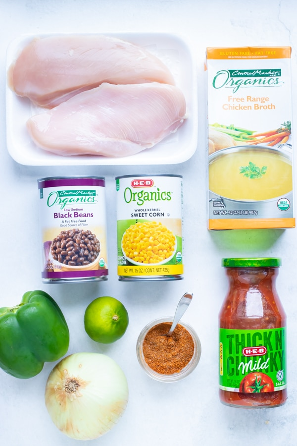 Chicken, corn, black beans, broth, lime, salsa, taco seasoning, onions, and peppers are the ingredients in this instant pot soup.