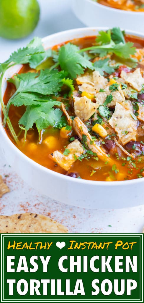 Pressure cooker chicken tortilla soup is topped with fresh cilantro and tortilla chips.