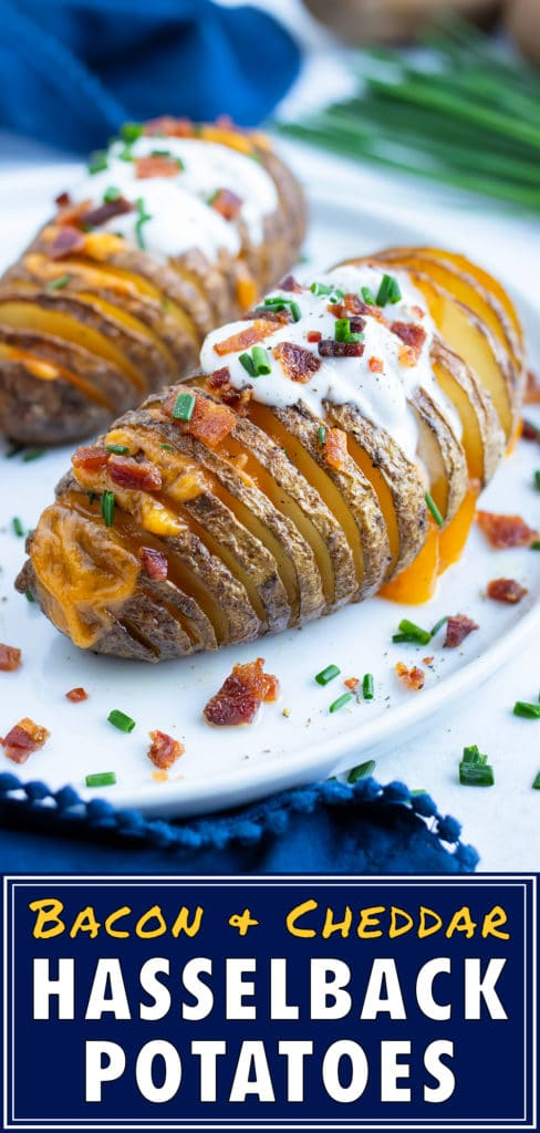 Loaded potatoes are served on a white plate with sour cream and chives.