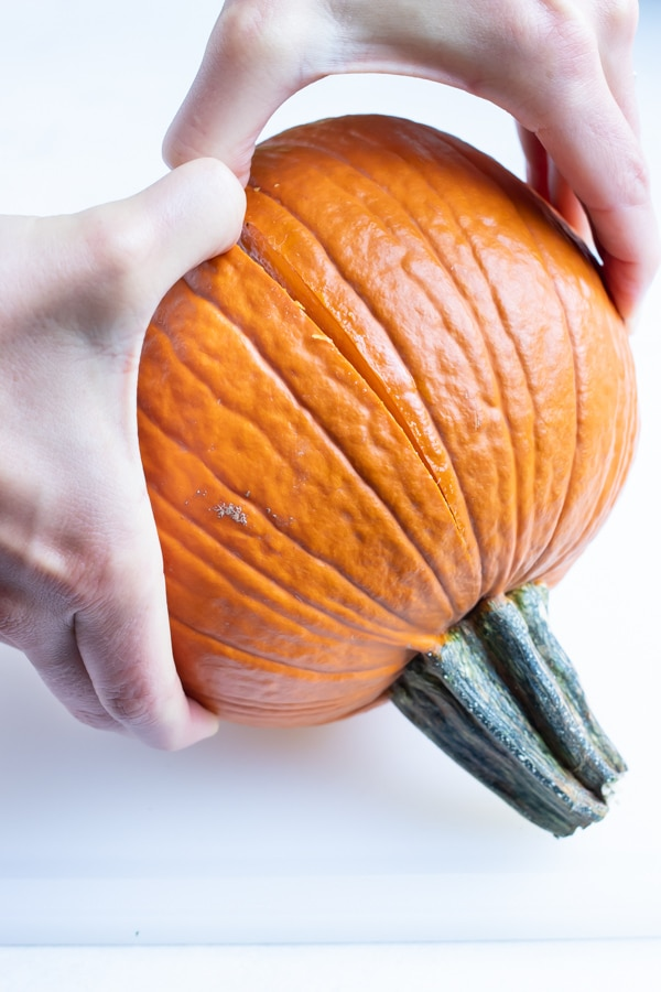 Pumpkin is separated before roasting in the oven.