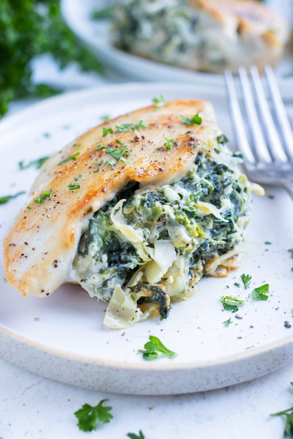 Low carb spinach artichoke chicken is served as a healthy, keto dinner.