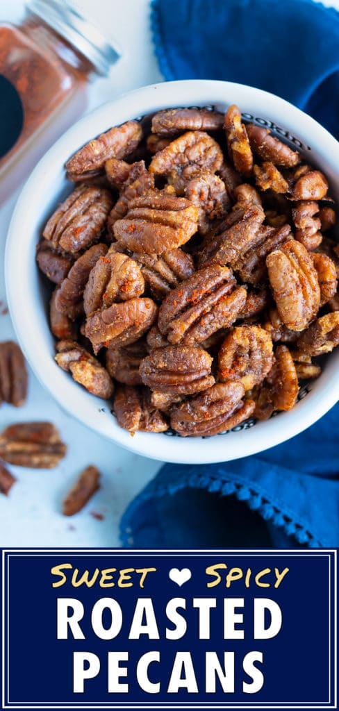 Cajun spiced pecan recipe is kept in a bowl on the counter for snacking.