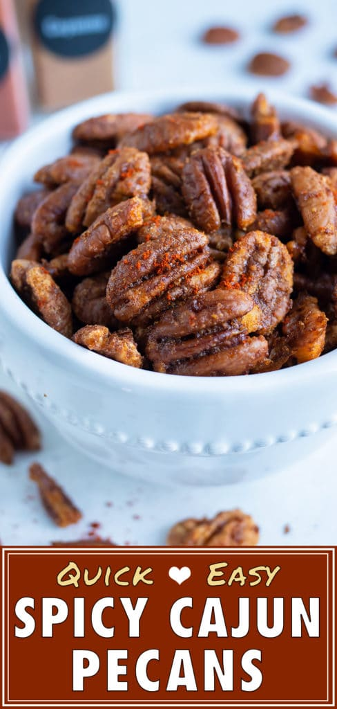 Spiced pecans are held in a white bowl for a keto-friendly snack.