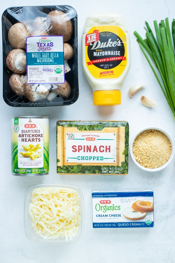 Frozen spinach, mushrooms, mayo, cream cheese, mozzarella and parmesan cheese, spices, breadcrumbs, green onions, and canned artichokes are the ingredients for this recipe.