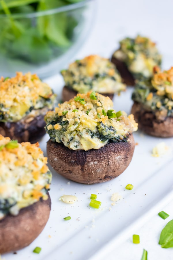 Filled mushrooms are served for a low-carb appetizer.