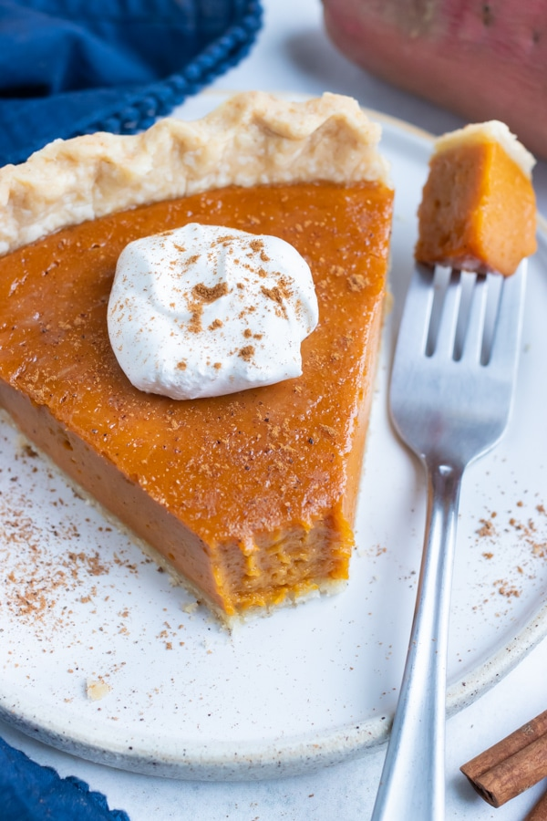 A piece of homemade sweet potato pie is eaten for Thanksgiving.