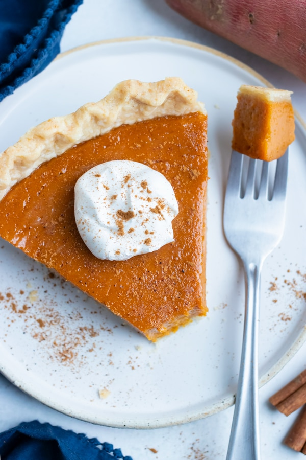 A bite is eaten out of this easy and creamy sweet potato pie.