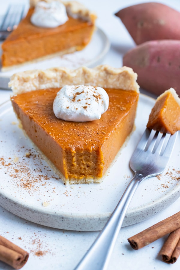 Southern sweet potato pie is served on a plate for a Thanksgiving dessert.