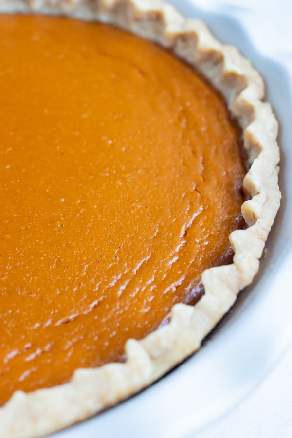 Easy sweet potato pie is baked until the crust is flakey and filling stiff.