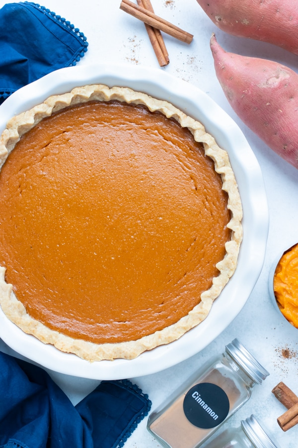Sweet potato pie is prepared to serve at Thanksgiving dinner.