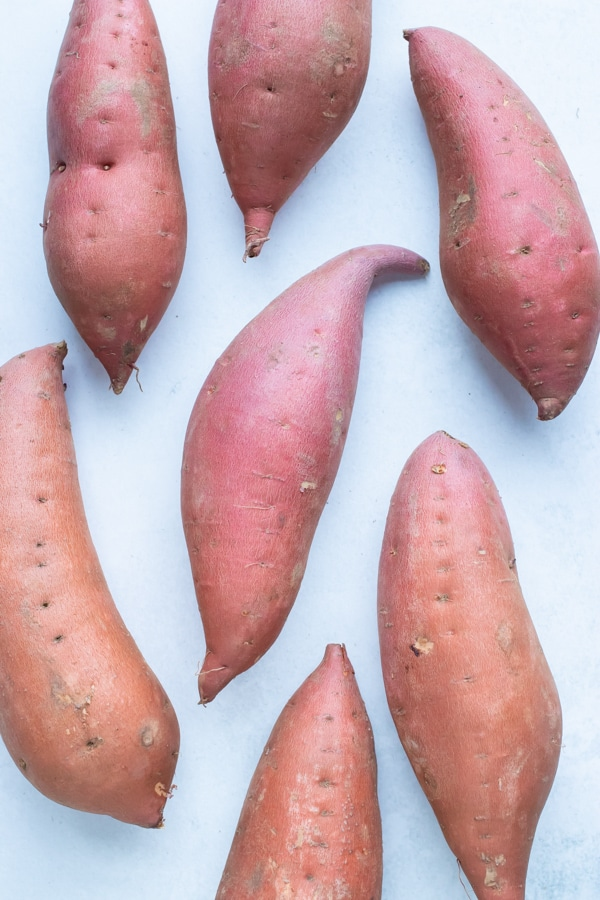 Sweet potatoes are shown on the counter before preparing for puree.
