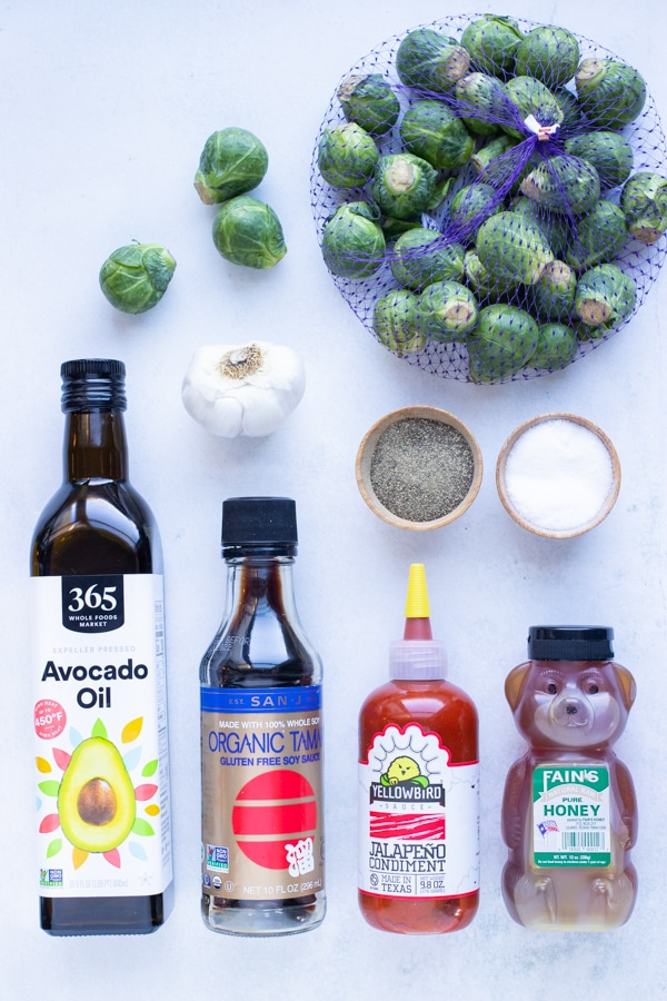 Brussels sprouts, salt, pepper, oil, garlic, honey, sriracha, and soy sauce are the ingredients used for this recipe.