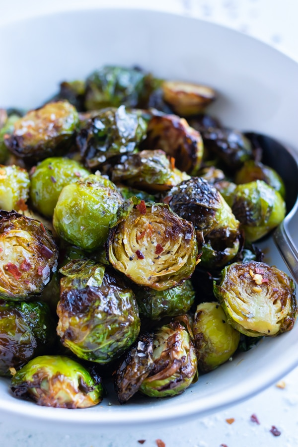 Crispy air fryer Brussels sprouts are served in a bowl for a healthy dish.