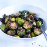 Air fryer Brussel Sprouts are served in a white bowl for a vegan side dish.