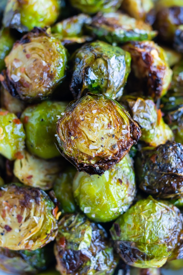 Healthy air fryer brussels sprouts are shown in a pile before serving.