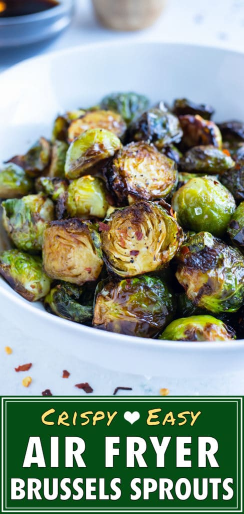 Air fryer roasted brussels sprouts are served in a white bowl.
