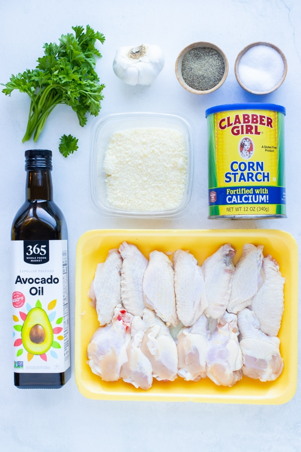Chicken wings, oil, corn starch, salt, pepper, garlic, and parmesan are the ingredients in this recipe.