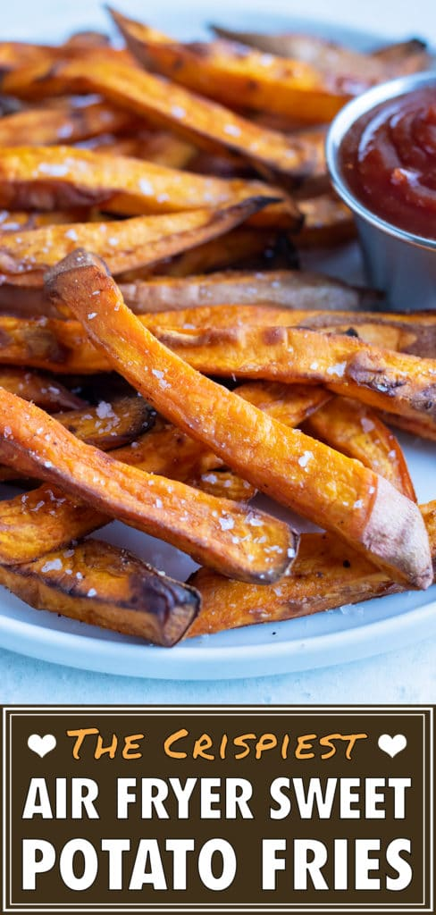 Crispy and healthy sweet potato fries made in your air fryer are served with ketchup.