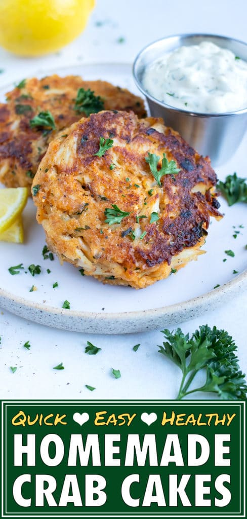 Skillet-seared crab cakes are served with fresh lemon juice, parsley, and tartar sauce.