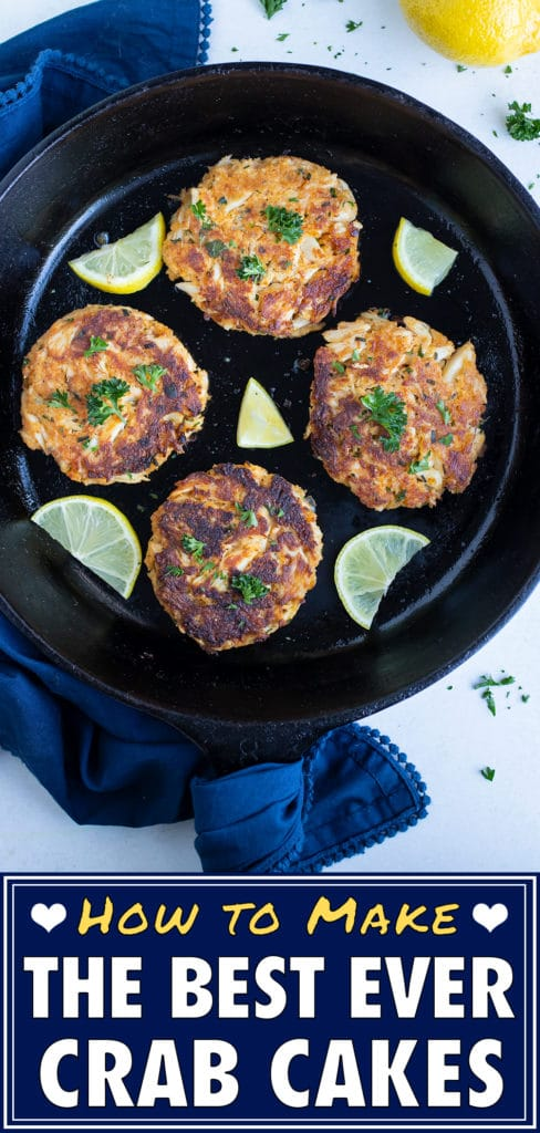 Low-carb crab cakes is served on skillet with fresh lemon as a main dish.