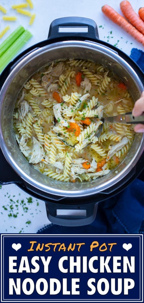Healthy chicken noodle soup is stirred with a metal spoon in the instant pot.