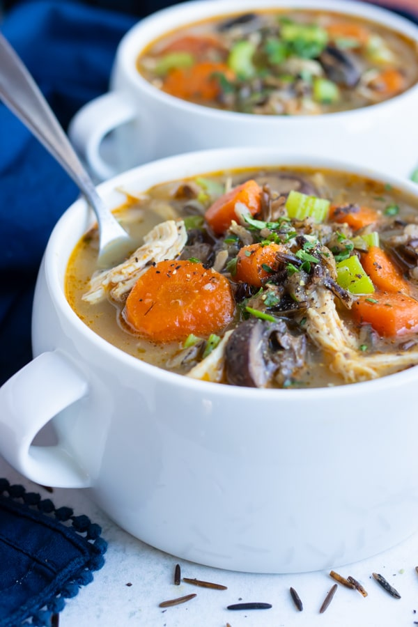 Pressure cooker wild rice soup is served in a bowl for a healthy dinner.