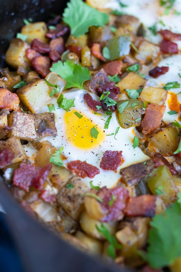 Eggs are cooked until over easy for this breakfast hash recipe.